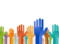 Image of raised hands in different colours and sizes.