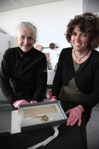 Antje Stubenrauch, restorer from the Archives of Lübeck, examines the Lübeck letter with Linda Ramsay, Head of Conservation at the National Record of Scotland, as it is returned to Scotland for an exhibition at the Scottish Parliament