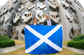 Presiding Officer Alex Fergusson MSP presenting a Saltire flag to the National Museums of Scotland