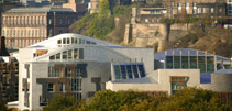 Photograph of the Parliament building with Edinburgh in the background