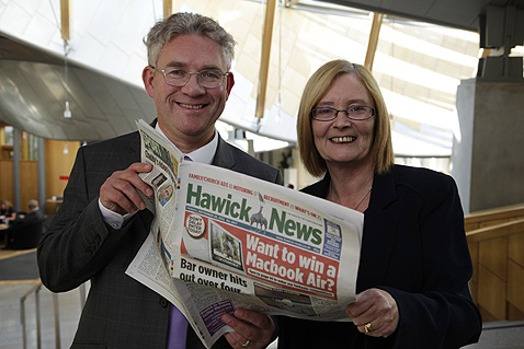 Presiding Officer Tricia Marwick MSP, right, and Kenneth Gibson MSP pictured reading a copy of the Hawick News ahead of the first Parliament Day which will be launched in Hawick in November
