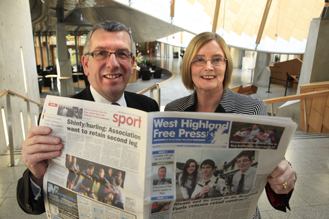 The Presiding Officer and David Stewart MSP reading the West Highland Free Press
