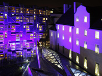 MSP building and Queensberry House at night