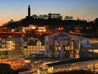 The Scottish Parliament and Calton Hill at night