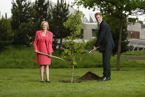 Tricia Marwick MSP and Andrew Fairbairn of the Woodland Trust Scotland Planting an oak tree to mark the Queen's Diamond Jubilee.