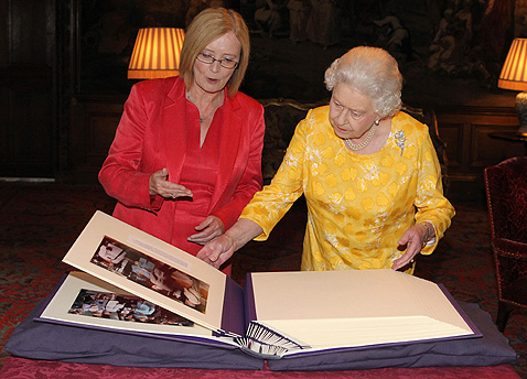 The Presiding Officer presents Her Majesty the Queen with a book of photographs at Holyrood Palace.