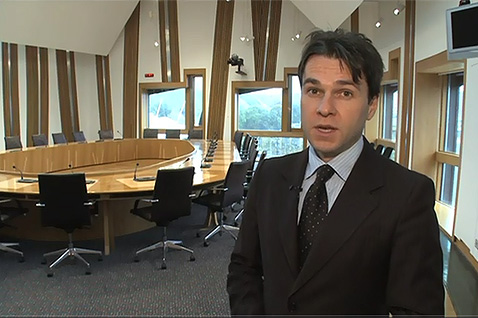 Andrew Johnston speaking during video explaining how Committee meetings run