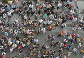 Crowd of people looking up (iStock)